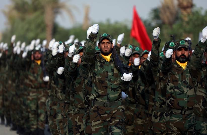 Members of the paramilitary Popular Mobilisation Forces (PMF) take part in their graduation ceremony at a military camp in Kerbala (photo credit: REUTERS/ABDULLAH DHIAA AL-DEEN)