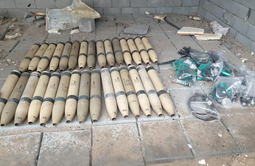 Unused Katyusha rockets found by the Iraqi Army are seen in Umm al-Izam (photo credit: IRAQI MEDIA SECURITY CELL/HANDOUT VIA REUTERS)