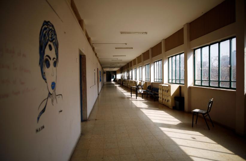An empty school is seen after Israel shut schools as part of precautionary measures against coronavirus, in Tel Aviv, Israel March 15, 2020 (photo credit: CORINNA KERN/REUTERS)