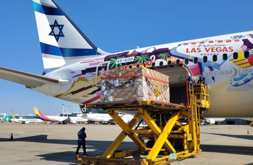 El Al flight carries reagents for coronavirus tests and protective suits from South Korea (photo credit: DEFENSE MINISTRY)