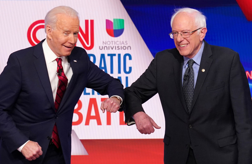 Democratic U.S. presidential candidates Senator Bernie Sanders and former Vice President Joe Biden at the 11th Democratic candidates debate of the 2020 U.S. presidential campaign in Washington, March 15, 2020 (photo credit: KEVIN LAMARQUE/REUTERS)