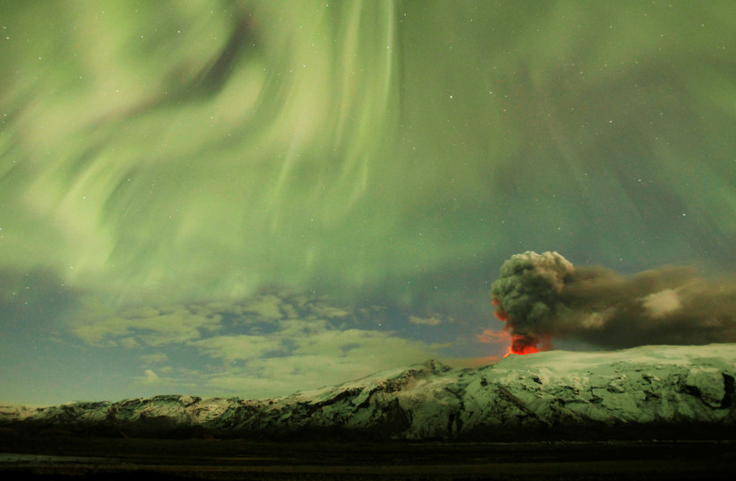 The Northern Lights are seen above the ash plume of a volcano in Eyjafjallajokull, Iceland, April 22, 2010 (photo credit: REUTERS)