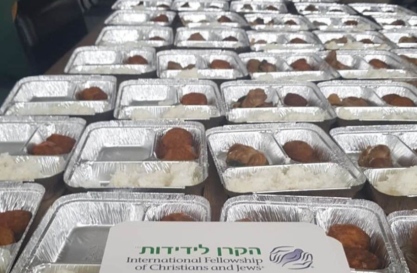 An emergency grant by The International Fellowship of Christians and Jews enables soup kitchen meal delivery to help those who can no longer come to them for aid (photo credit: IFCJ)