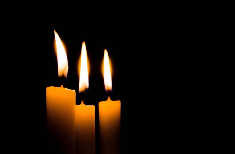 Candles burn (photo credit: CALEB HERNANDEZ BELMONTE-/UNSPLASH)