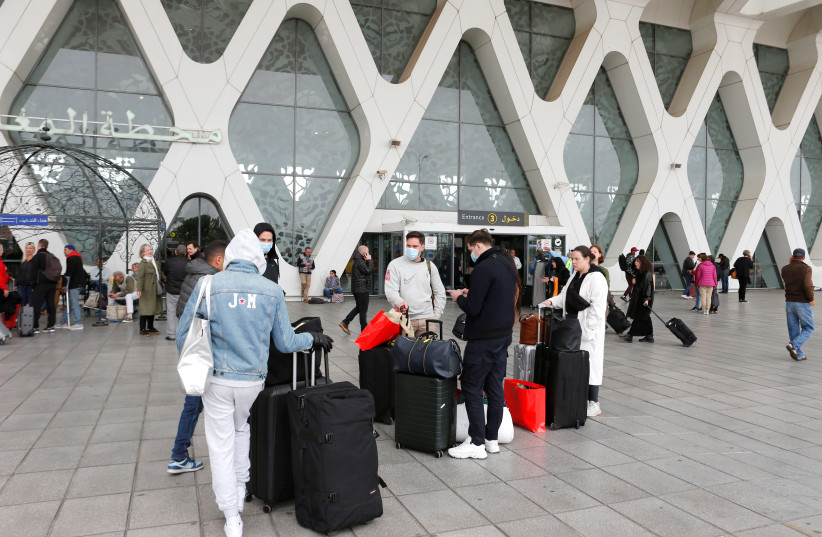 Tourists wait to be repatriated to their countries from Marrakech airport, Morocco (photo credit: YOUSSEF BOUDLAL / REUTERS)