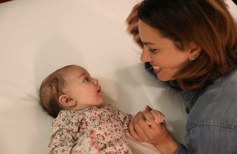 THE WRITER with daughter Hanna, then three months old (photo credit: Courtesy)
