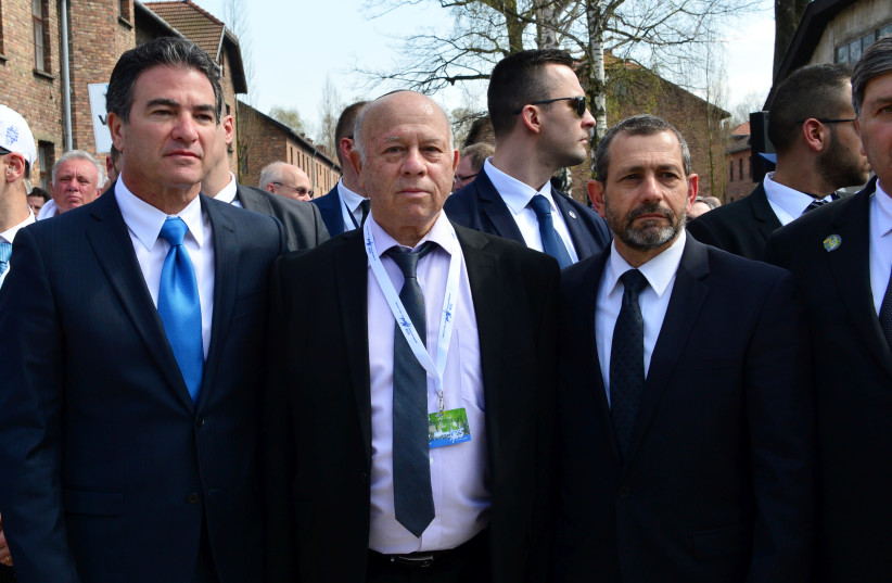 DR. SHMUEL ROSENMAN, co-founder and chairman of the International March of the Living, flanked by Mossad head Yossi Cohen (left) and Shin Bet head Nadav Argaman in 2018 (photo credit: YOSSI ZELIGER)