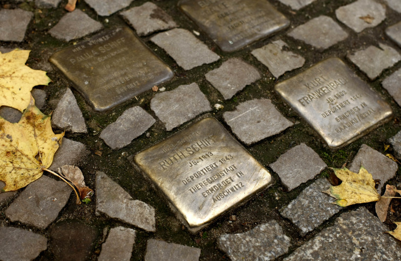 A MAIN character's journey takes him to Theresienstadt and Auschwitz. Memorial plaques commemorating German Jews murdered in those two concentration camps dot the Berlin pavement in 2008 (photo credit: REUTERS/FABRIZIO BENSCH)