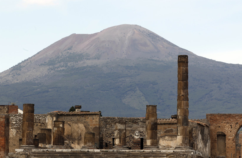 A partial view of the ancient archaeological site of Pompeii is pictured in front of Mount Vesuvius April 17, 2014 (photo credit: REUTERS/CIRO DE LUCA)