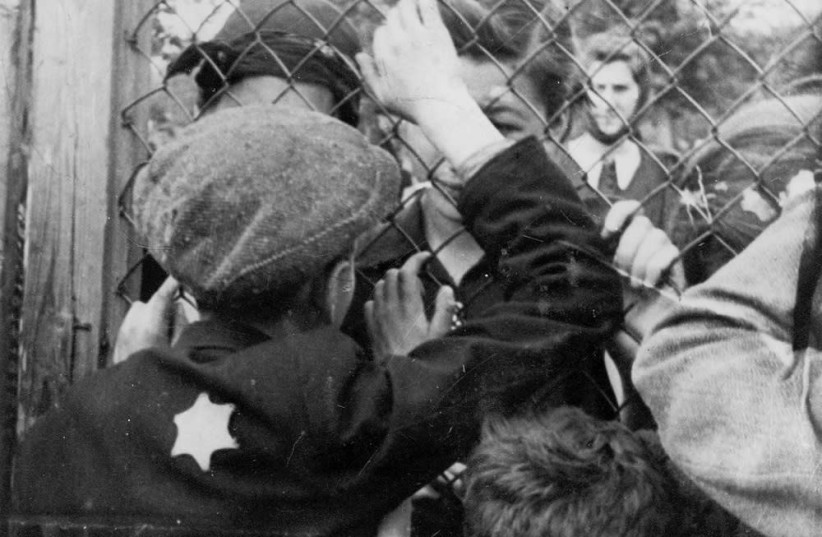 Children say goodbye to their friends at the fence of the Lodz ghetto. (photo credit: YAD VASHEM PHOTO ARCHIVES)