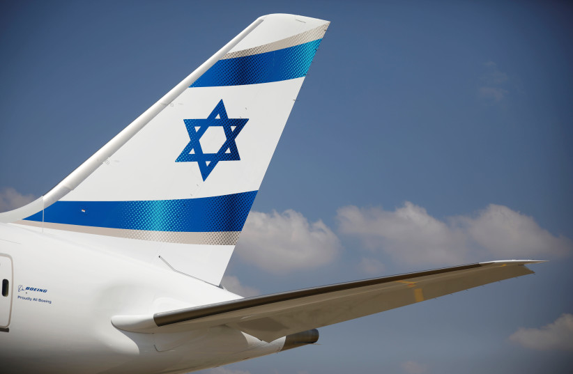 An Israeli flag is seen on the first of Israel's El Al Airlines order of 16 Boeing 787-9 Dreamliner jets, as it lands at Ben Gurion International Airport, near Tel Aviv (photo credit: REUTERS/AMIR COHEN)