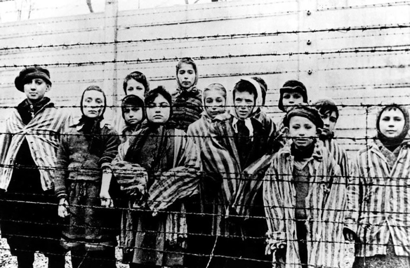 CHILD SURVIVORS on the day of their liberation from Auschwitz (Seventh and eighth from left Marta Wise and her sister Eva Slonim)    (photo credit: YAD VASHEM)