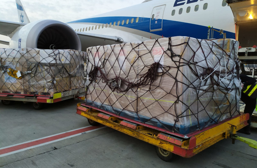 Tens of thousands of coronavirus tests and processing equipment arrived from China after negotiations with Beijing Genomics Institute (photo credit: EL AL)