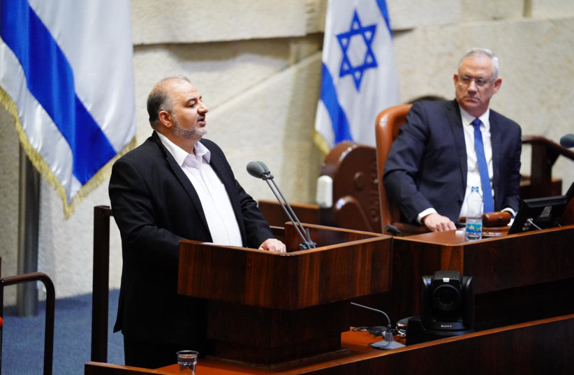 Joint List MK Mansour Abbas alongside Blue and White leader Benny Gantz on Holocaust Remembrance Day, 2020 (photo credit: KNESSET SPOKESWOMAN - ADINA WALLMAN)