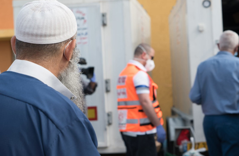A Muslim man watching food packages for the month of Ramadan being delivered by Home Front Command  (photo credit: IDF SPOKESPERSON'S UNIT)