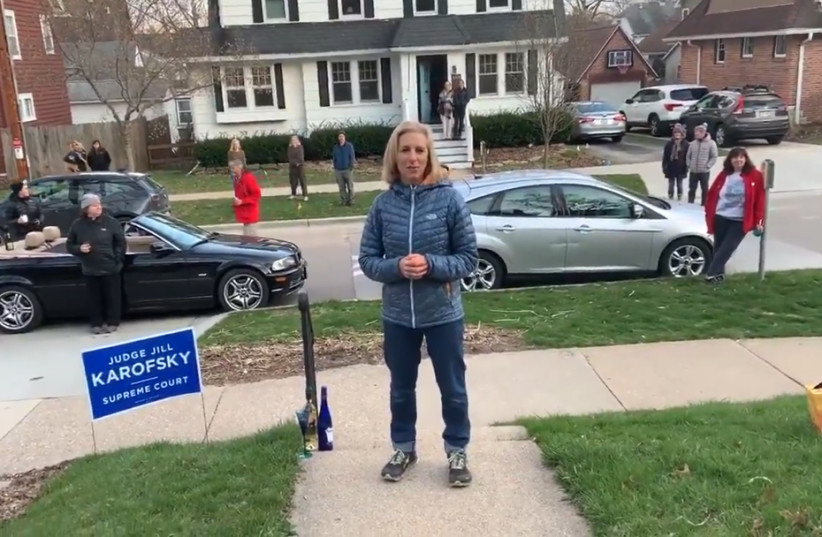 Jill Karofsky celebrates her election to Wisconsin's Supreme Court at a social distance outside her Madison home, April 13, 2020 (photo credit: SCREENSHOT/JTA)
