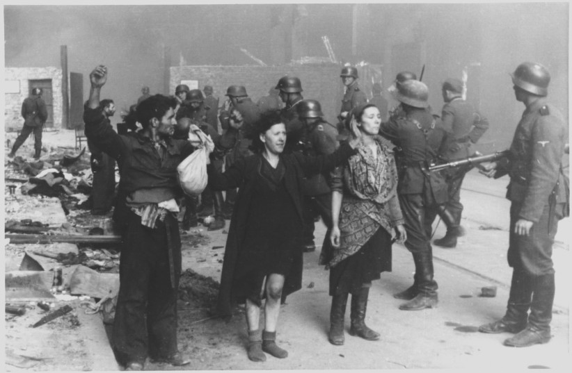 Jews held at gunpoint by Nazis during the Warsaw Ghetto Uprising. (photo credit: Wikimedia Commons)