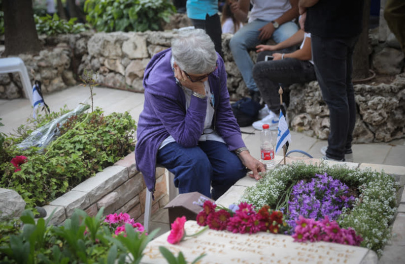 MOURNING AT Jerusalem's Mount Herzl military cemetery on Memorial Day, on May 8, 2019 (photo credit: HADAS PARUSH/FLASH90)