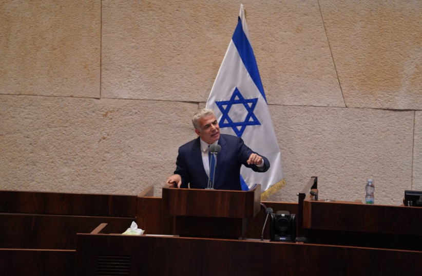 Yesh Atid leader Yair Lapid participates in a discussion on the government formation bill, April 2020. (photo credit: KNESSET SPOKESPERSON'S OFFICE)