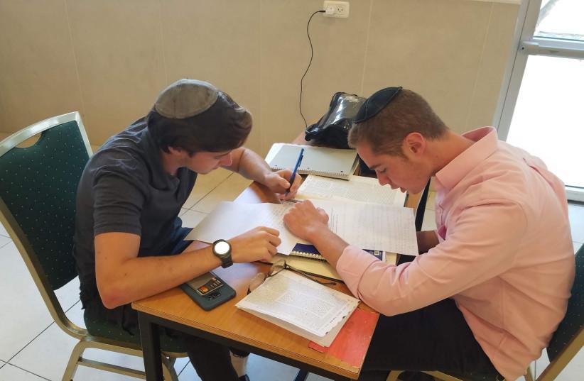 Students learning at Yeshivat Migdal HaTorah (photo credit: YESHIVA MIGDAL HATORAH)