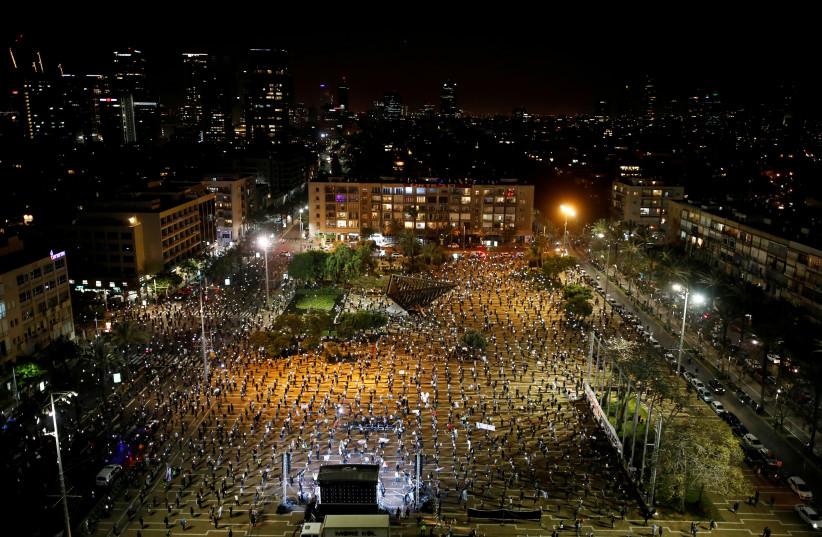 PEOPLE PROTEST against Prime Minister Benjamin Netanyahu in Tel Aviv.  (photo credit: REUTERS)