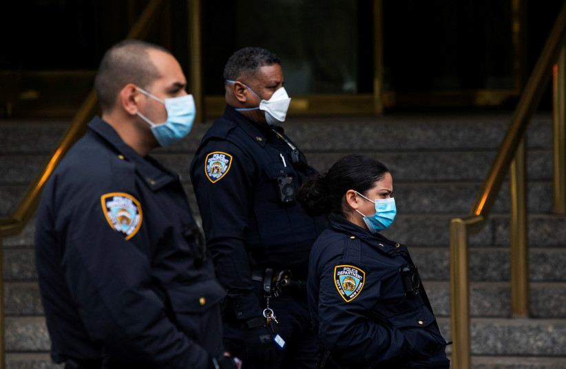 New York Police officers wear protective masks, New York, U.S., April 18, 2020 (photo credit: EDUARDO MUNOZ / REUTERS)