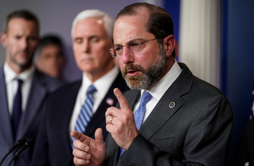 US Secretary of Health and Human Services Alex Azar speaks during a news briefing on the administration's response to the coronavirus at the White House in Washington, March 15, 2020. (photo credit: JOSHUA ROBERTS / REUTERS)