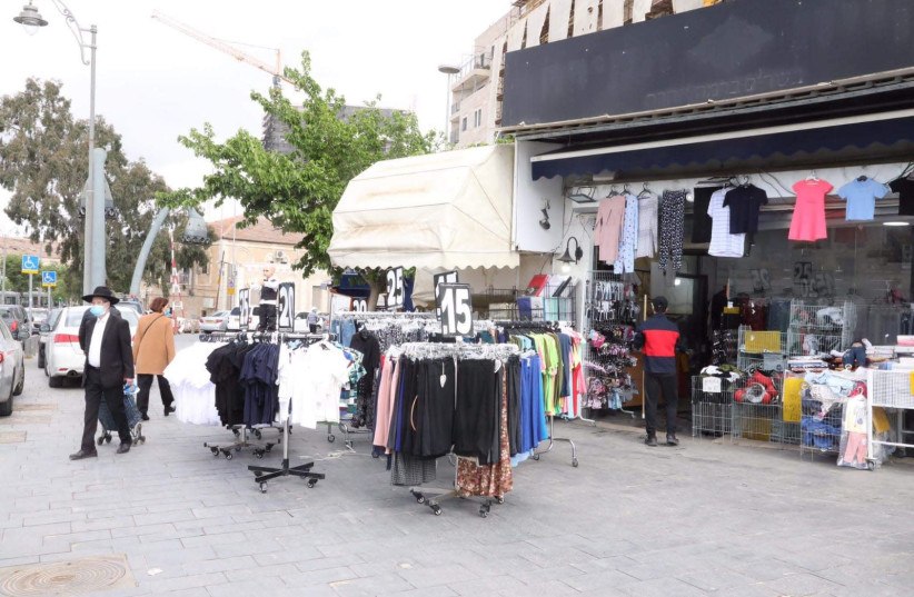 Shops begin to open in Jerusalem's Mahane Yehuda Market as the coronavirus restrictions on business are eased, April 26, 2020 (photo credit: MARC ISRAEL SELLEM/THE JERUSALEM POST)