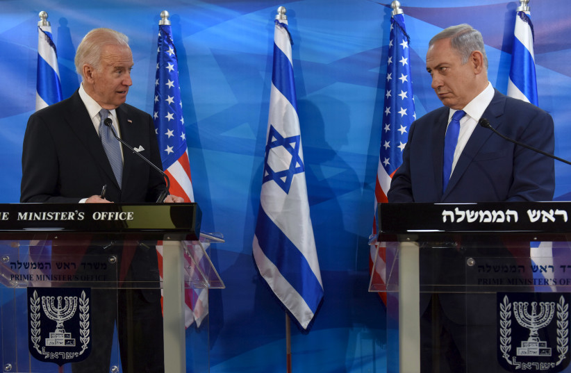Then-US Vice President Joe Biden (L) and Israeli Prime Minister Benjamin Netanyahu look at each other as they deliver joint statements during their meeting in Jerusalem March 9, 2016 (photo credit: DEBBIE HILL/REUTERS)
