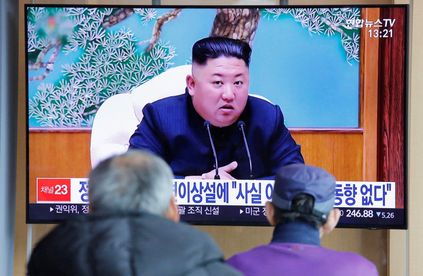 South Korean people watch a TV broadcasting a news report on North Korean leader Kim Jong Un in Seoul, South Korea, April 21, 2020 (photo credit: REUTERS/HEO RAN)
