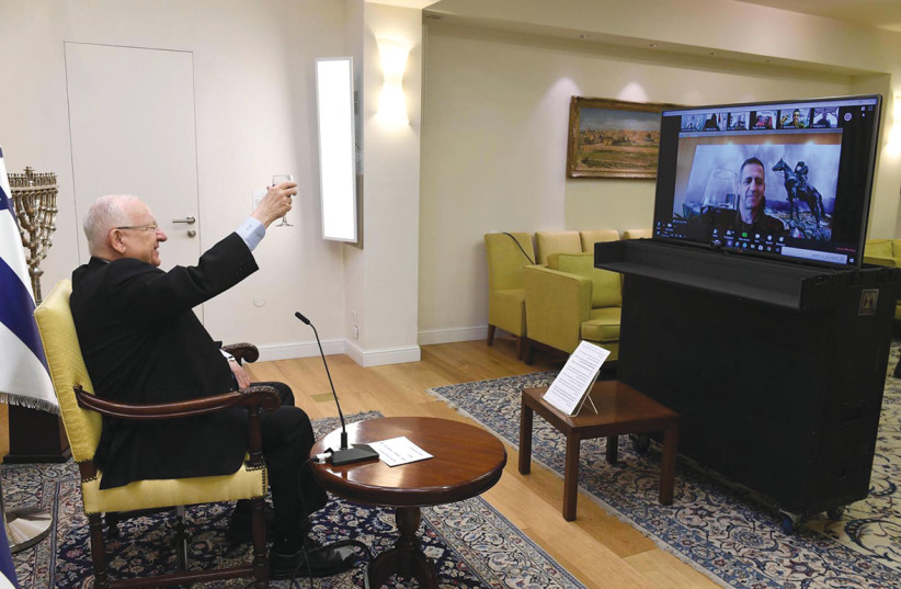 Diaspo President Reuven Rivlin and IDF Chief of Staff Lt.-Gen. Aviv Kochavi host a Zoom call with lone soldiers in Israel and around the world on April 7, instead of hosting them at the President's Residence as in previous years. (photo credit: MARK NEYMAN/GPO)