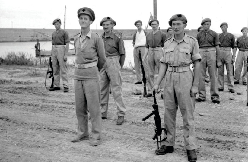 Members of 2 SAS on parade for an inspection by Gen. Montgomery, following their successful participation in the capture, behind enemy lines, of the port of Termoli in Italy. On the left is Maj. E. Scratchley DSO, commanding the SAS detachment, while on the right is Capt. Roy Farran holding a German (photo credit: UK GOVERNMENT/WIKIMEDIA COMMONS)