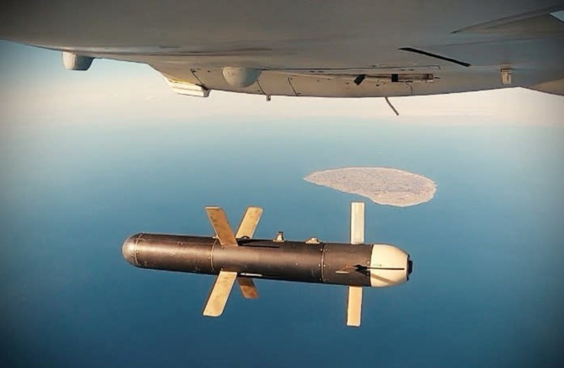 An Iranian Shahed 171 drone dropping a bomb as part of a military exercise in the Gulf, in Iran (photo credit: REUTERS)