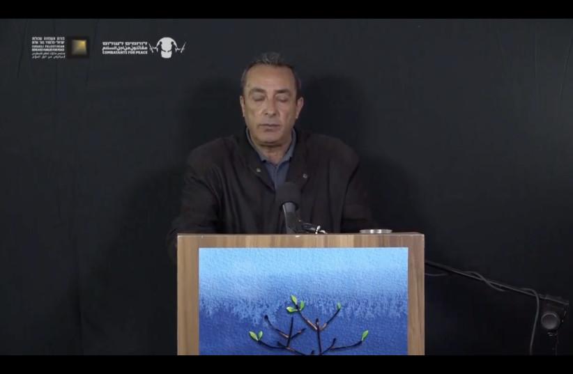 Aisha El-Rabi's husband Yaakub speaks at the Israeli-Palestinian Memorial Day Ceremony (photo credit: screenshot)