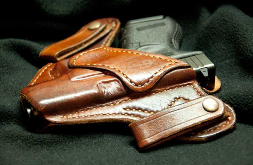 Gun in a holster (Illustrative) (photo credit: Wikimedia Commons)