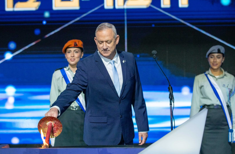 Blue and White leader Benny Gantz lights a torch at Israel's offical Independence Day ceremony on April 28, 2020 (photo credit: ELAD MALKA)