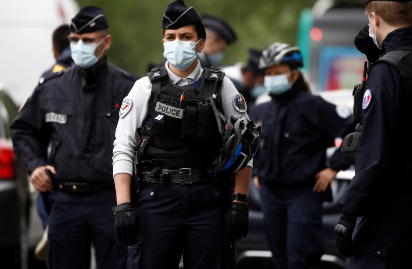 French police officers in Paris, France, April 28, 2020. (photo credit: REUTERS/BENOIT TESSIER)