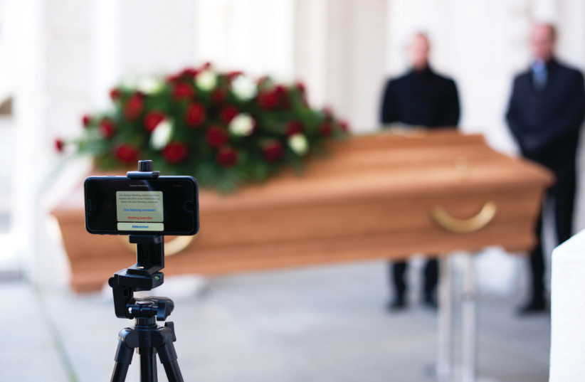 Funerals, which have been restricted to just first-degree relatives, are now taking place with participants joining through video links. (photo credit: Courtesy)