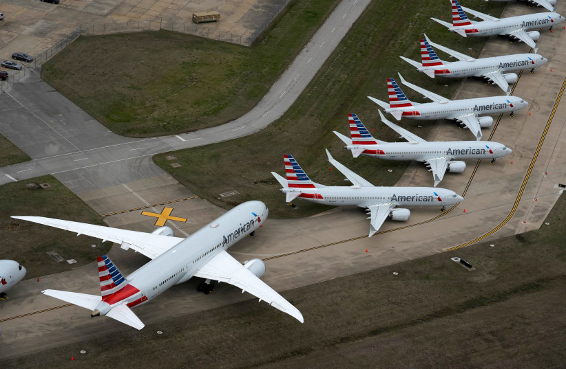 American Airlines passenger planeS parked at Tulsa International Airport in Tulsa, Oklahoma, U.S. March 23, 2020 (photo credit: REUTERS/NICK OXFORD/FILE PHOTO)
