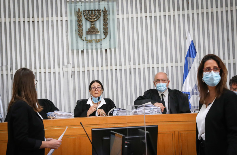 Israeli Supreme Court President Esther Hayut and Supreme court Justices arrive to a court session on petitions filed against the proposed government at the Supreme Court in Jerusalem on May 3, 2020 (photo credit: YOSSI ZAMIR)