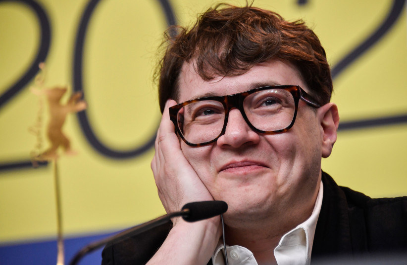 "Russian director Ilya Khrzhanovsky smiling at a press conference for the film ""Dau: Natasha"" screened in competition in Berlin, Germany on February 26, 2020. (photo credit: JOHN MACDOUGALL/AFP VIA GETTY IMAGES/JTA)"