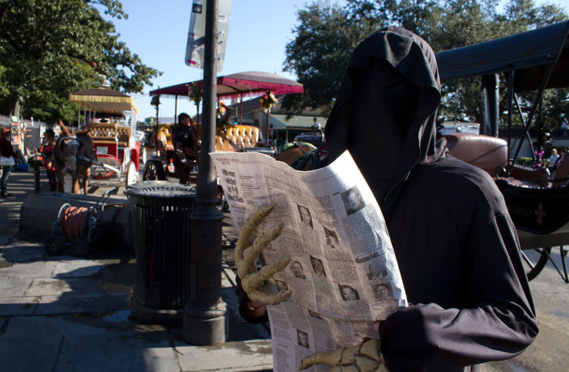 A man dressed as the 'Grim Reaper.' (photo credit: WIKIPEDIA)