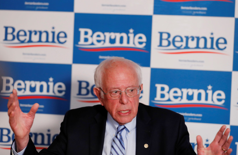 Bernie Sanders responds to a question from a reporter  (photo credit: LUCAS JACKSON / REUTERS)
