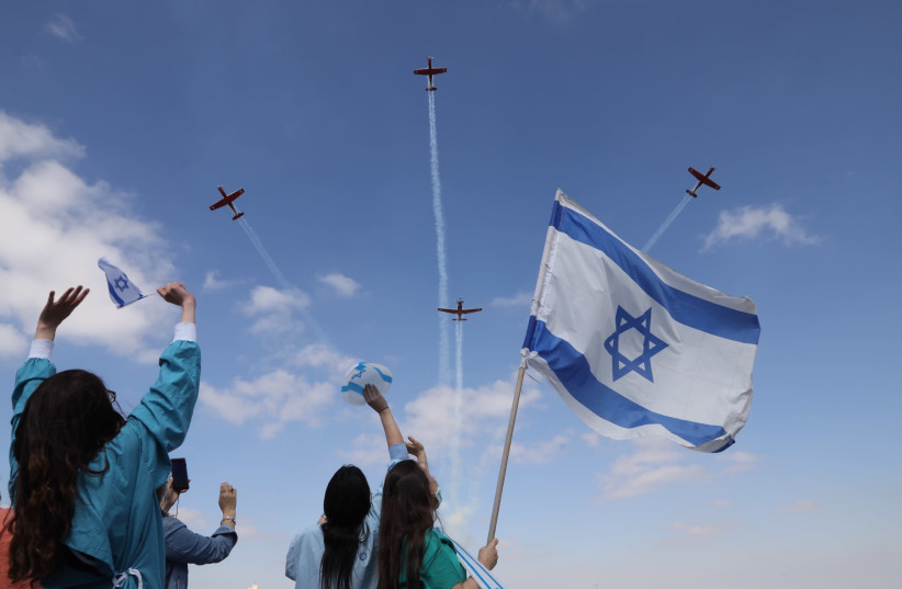 Medical staff at Jerusalem's Shaare Zedek Medical Center wave at an Israel Air Force flyover on Independence Day (photo credit: MARC ISRAEL SELLEM)