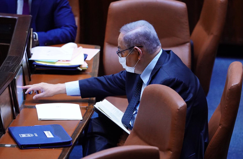 Prime Minister Benjamin Netanyahu, in protective mask, attends the session of the Knesset plenum, May 7, 2020 (photo credit: KNESSET SPOKESWOMAN - ADINA WALLMAN)