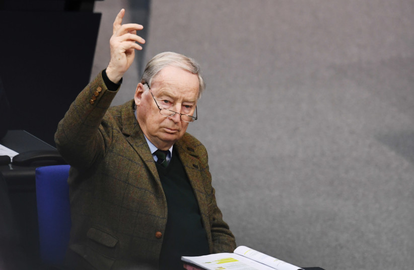 Alternative for Germany (AfD) leader Alexander Gauland raises his arm during a plenum session at the lower house of parliament, Bundestag, in Berlin, Germany March 13, 2020 (photo credit: ANNEGRET HILSE / REUTERS)