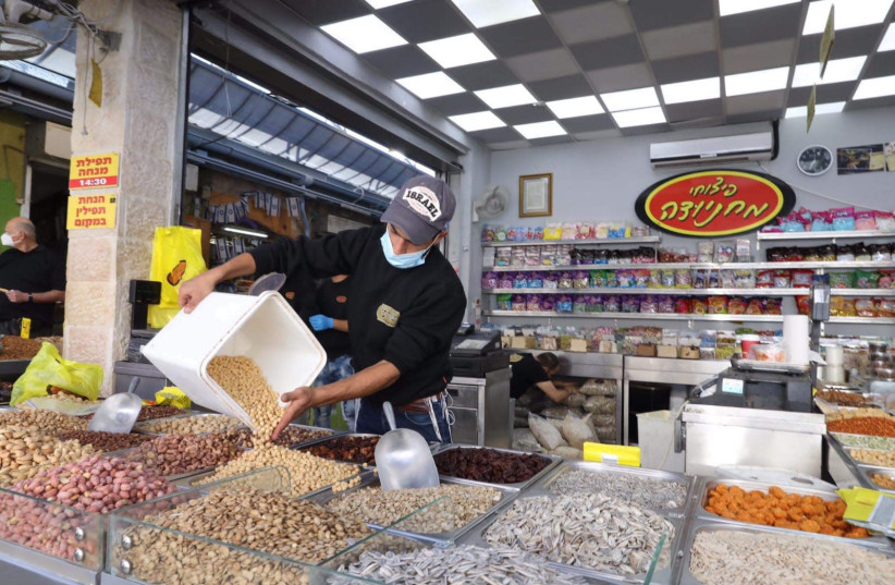Mahane Yehuda market reopens after coronavirus restrictions had it shut down for the most part (photo credit: MARC ISRAEL SELLEM)