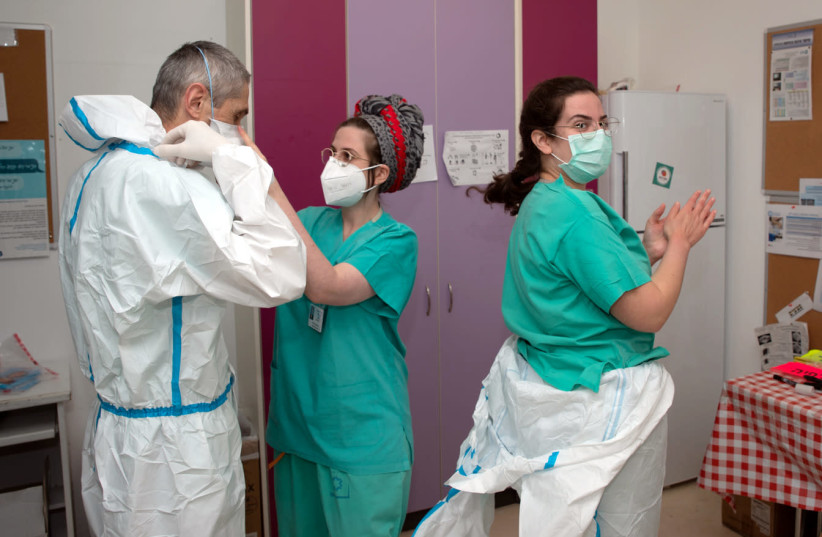 THE HIGHEST standards of personal protective equipment were required for all corona patient interactions (photo credit: TAL CHERES)
