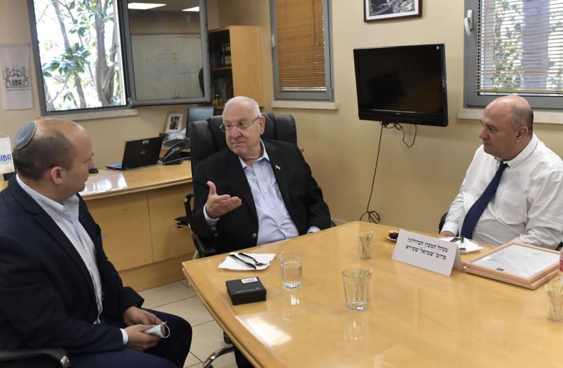 From Left to Right, Defense Minister Naftali Bennett, President Reuven Rivlin, Director of the IIBR Shmuel Shafira   (photo credit: KOBI GIDEON/GPO)
