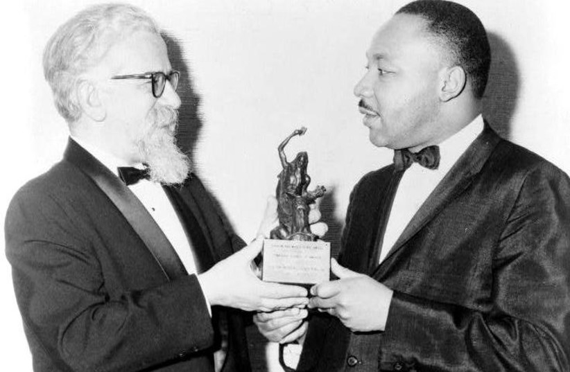 RABBI ABRAHAM JOSHUA HESCHEL presents a Judaism and World Peace award to Dr. Martin Luther King, Jr. in 1965. (photo credit: Wikimedia Commons)